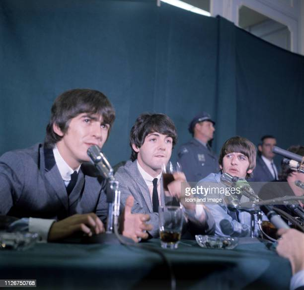 George Harrison , Paul McCartney, Ringo Starr and John Lennon of the Beatles, upon returning to New York to play Shea Stadium, sit for a press...