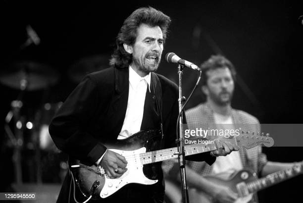 George Harrison performs during a concert for the Princes Trust, attended by Princess Diana and Prince Charles, at Wembley Stadium, London, circa 1987