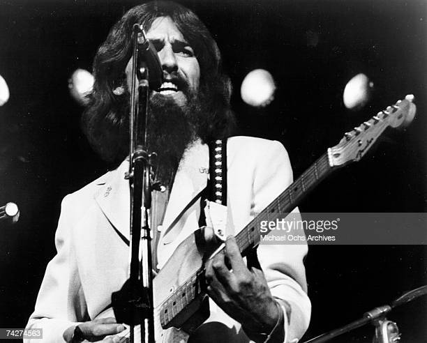 George Harrison performs onstage at the Concert for Bangladesh which was held at Madison Square Garden on August 1, 1971 in New York City, New York.