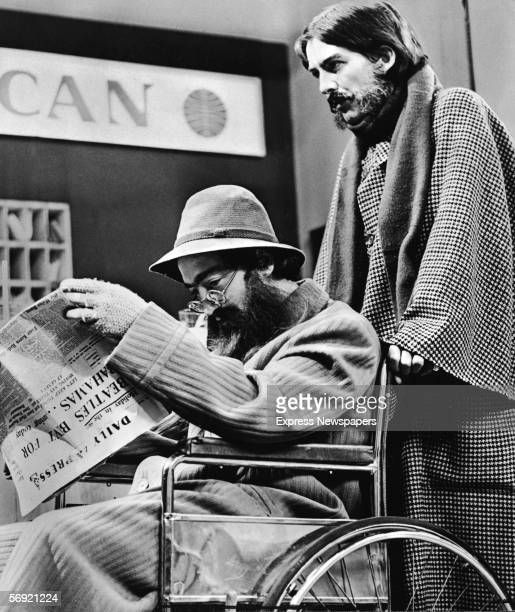 George Harrison pushes John Lennon both of the British pop group the Beatles in a wheelchair as they travel in unconvincing disguises past a Pan...