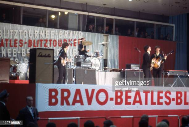 George Harrison , Ringo Starr, Paul McCartney and John Lennon of The Beatles perform on stage at Grugahalle during their Bravo-Beatles-Blitztournee...