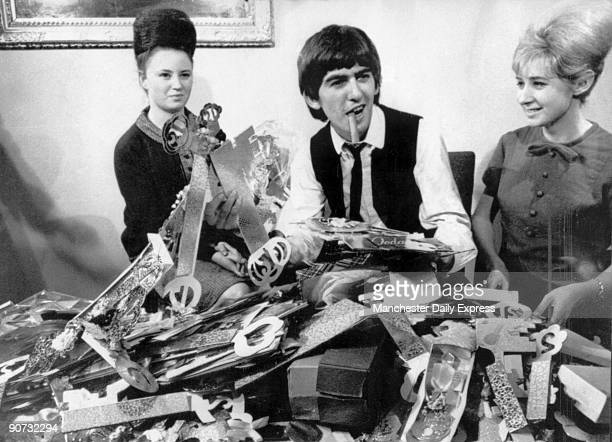 George Harrison the guitarist from the 1960s pop group 'The Beatles' is pictured here celebrating his 21st birthday Harrison formed the Beatles in...
