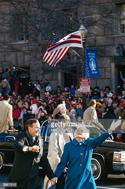 George Herbert Walker Bush, the 41st president of the United States holding hands with his wife Barbara on his inaugural parade.