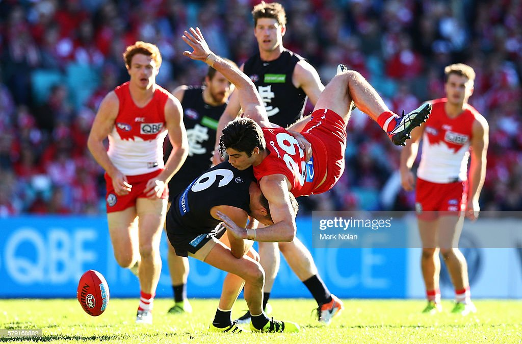 George Hewett of the Swans and Kade Simpson of Carlton contest a mark during the round 18 AFL match between the Sydney Swans and the Carlton Blues at Sydney Cricket Ground on July 23, 2016 in Sydney, Australia.