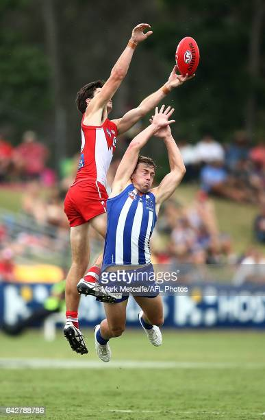 George Hewett of the Swans and Trent Dumont of the Kangaroos compete for a mark during the 2017 JLT Community Series match between the Sydney Swans...