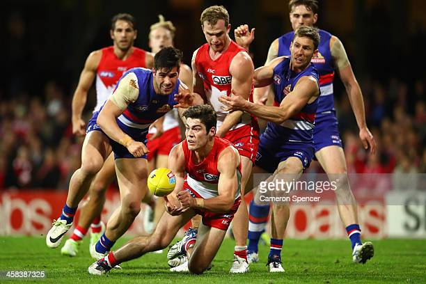 George Hewett of the Swans handpasses during the round 15 AFL match between the Sydney Swans and the Western Bulldogs at Sydney Cricket Ground on...