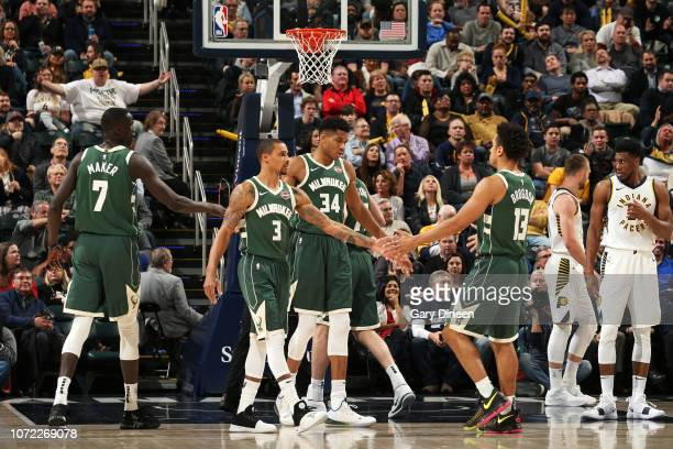 21caef216658 George Hill and Giannis Antetokounmpo of the Milwaukee Bucks hifive  teammates during the game against the