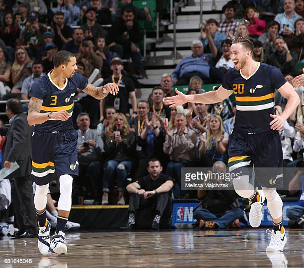 George Hill and Gordon Hayward of the Utah Jazz highfive during a game against the Detroit Pistons on January 13 2017 at vivintSmartHome Arena in...