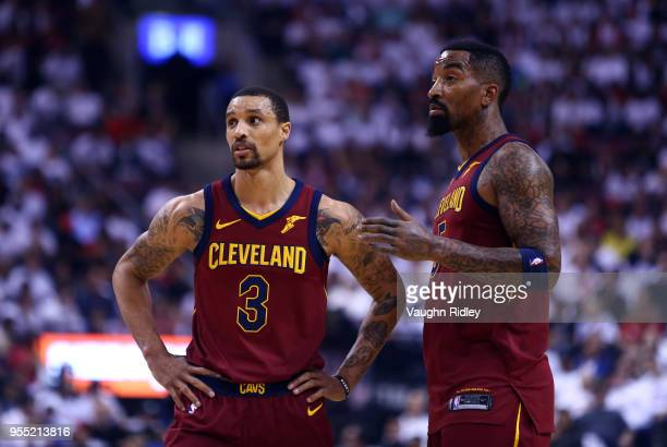 George Hill and JR Smith of the Cleveland Cavaliers look on in the first half of Game Two of the Eastern Conference Semifinals against the Toronto...