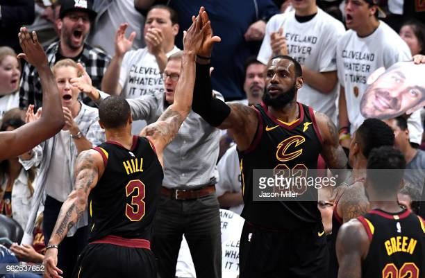 George Hill and LeBron James of the Cleveland Cavaliers react after a play in the second half against the Boston Celtics during Game Six of the 2018...