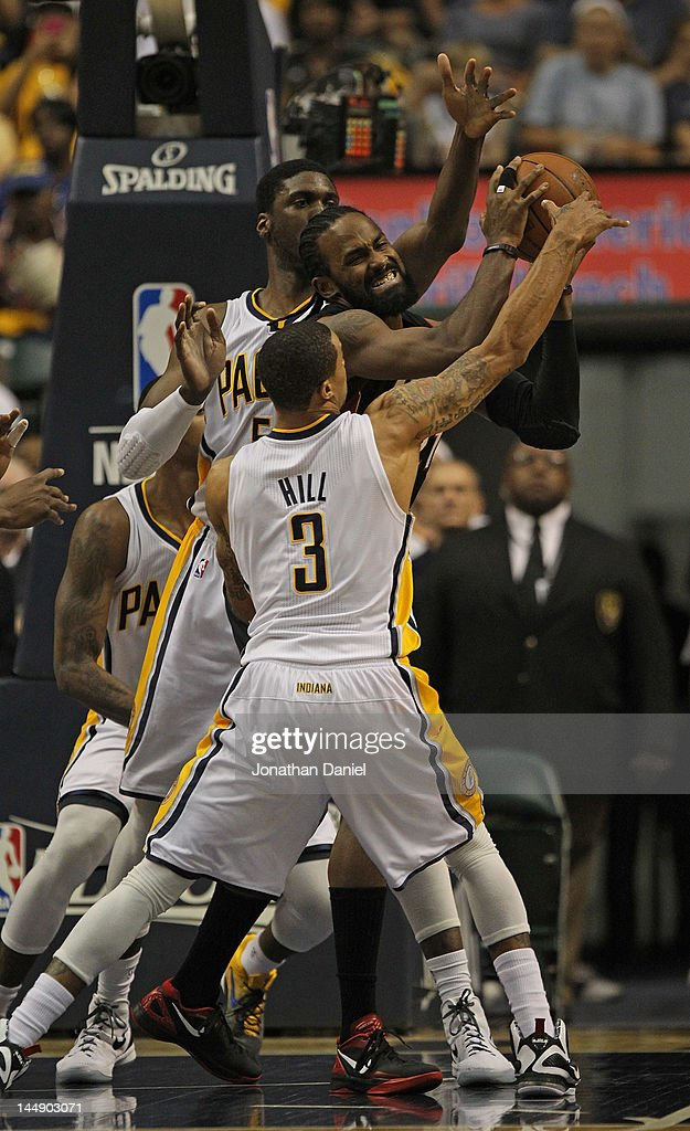 George Hill #3 and Roy Hibbert #55 of the Indiana Pacers pressure Ronny Turiaf #21 of the Miami Heat in Game Four of the Eastern Conference Semifinals in the 2012 NBA Playoffs at Bankers Life Fieldhouse on May 20, 2012 in Indianapolis, Indiana.
