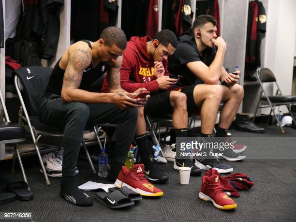 George Hill Jordan Clarkson and Ante Zizic of the Cleveland Cavaliers look on in the locker room prior to Game One of the 2018 NBA Finals against the...
