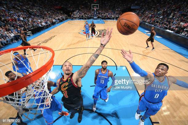 George Hill of the Cleveland Cavaliers and Russell Westbrook of the Oklahoma City Thunder go for a rebound during the game on February 13 2018 at...