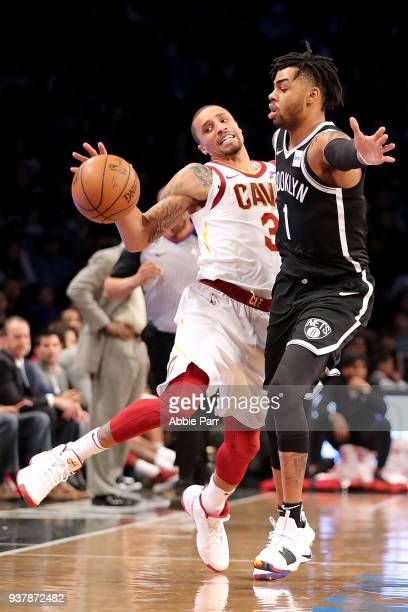 George Hill of the Cleveland Cavaliers collides with D'Angelo Russell of the Brooklyn Nets in the third quarter during their game at Barclays Center...