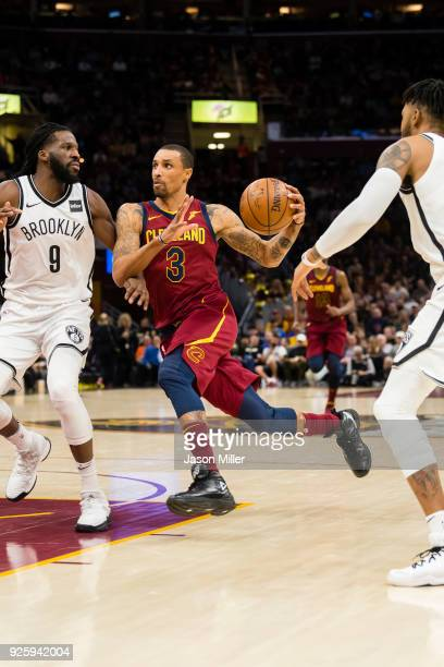 George Hill of the Cleveland Cavaliers drives around DeMarre Carroll of the Brooklyn Nets during the first half at Quicken Loans Arena on February 27...
