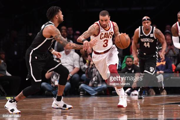 George Hill of the Cleveland Cavaliers handles the ball against D'Angelo Russell of the Brooklyn Nets during the game at Barclays Center on March 25...