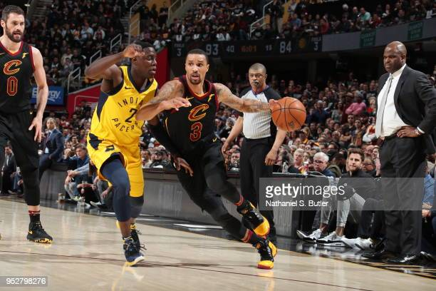 George Hill of the Cleveland Cavaliers handles the ball against Darren Collison of the Indiana Pacers in Game Seven of Round One of the 2018 NBA...