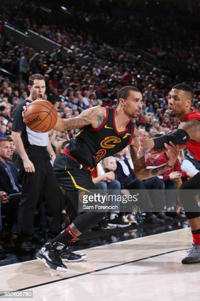George Hill of the Cleveland Cavaliers handles the ball during the game against the Portland Trail Blazers on March 15 2018 at the Moda Center in...