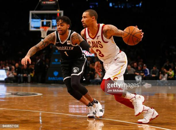George Hill of the Cleveland Cavaliers in action against D'Angelo Russell of the Brooklyn Nets at Barclays Center on March 25 2018 in the Brooklyn...