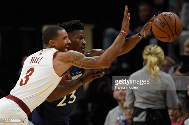 George Hill of the Cleveland Cavaliers knocks the ball away from Jimmy Butler of the Minnesota Timberwolves during the first quarter of the game on...