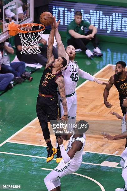 George Hill of the Cleveland Cavaliers lays up a shot against Aron Baynes of the Boston Celtics during Game Five of the 2018 NBA Eastern Conference...