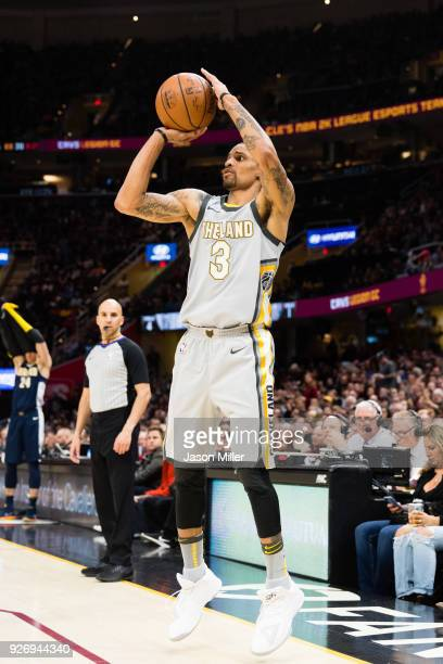 George Hill of the Cleveland Cavaliers shoots against the Denver Nuggets during the second half at Quicken Loans Arena on March 3 2018 in Cleveland...
