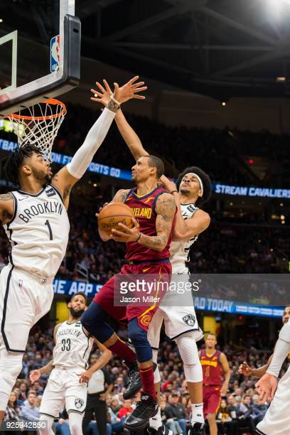 George Hill of the Cleveland Cavaliers shoots over D'Angelo Russell and Jarrett Allen of the Brooklyn Nets during the first half at Quicken Loans...