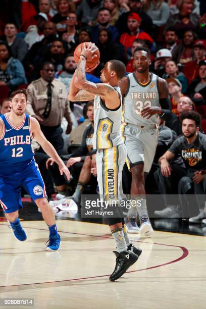 George Hill of the Cleveland Cavaliers shoots the ball against the Philadelphia 76ers on March 1 2018 at Quicken Loans Arena in Cleveland Ohio NOTE...