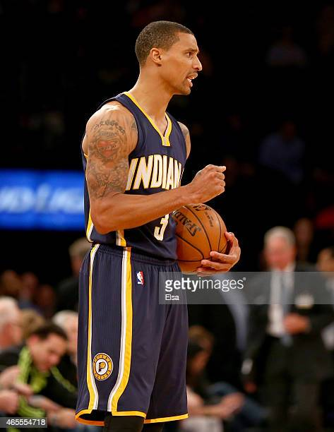 George Hill of the Indiana Pacers celebrates the win over the New York Knicks at Madison Square Garden on March 7 2015 in New York CityThe Indiana...