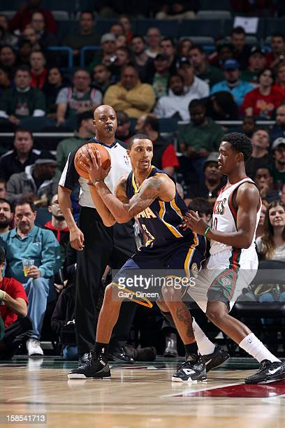 George Hill of the Indiana Pacers controls the ball against Doron Lamb of the Milwaukee Bucks during the game on December 18 2012 at the BMO Harris...