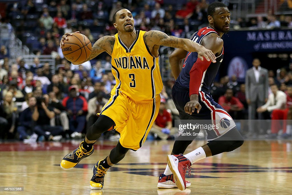 George Hill #3 of the Indiana Pacers dribbles past John Wall #2 of the Washington Wizards in the second half at Verizon Center on March 25, 2015 in Washington, DC. The Indiana Pacers won, 103-101.