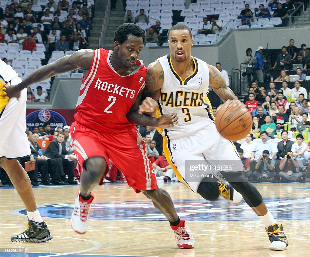 George Hill #3 of the Indiana Pacers dribbles past Patrick Beverley #2 of the Houston Rockets trys to defend during the NBA game at the Mall of Asia Arena on October 10, 2013 in Manila, Philippines.