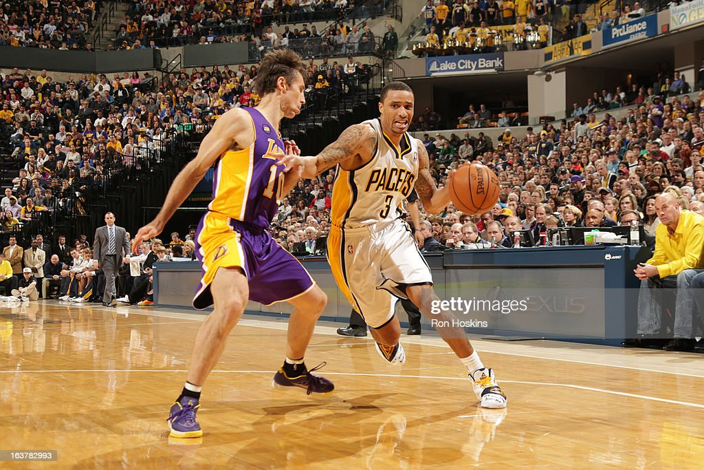 George Hill #3 of the Indiana Pacers drives against Steve Nash #10 of the Los Angeles Lakers on March 15, 2013 at Bankers Life Fieldhouse in Indianapolis, Indiana.