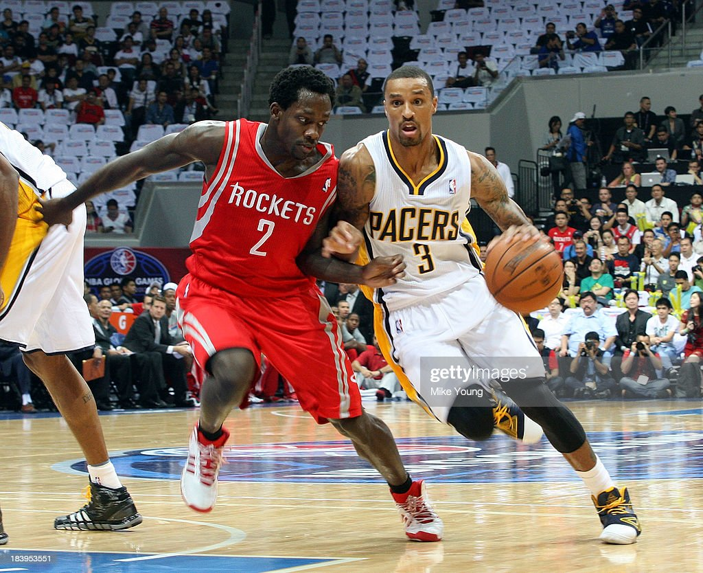 George Hill #3 of the Indiana Pacers drives past Patrick Beverly #2 of the Houston Rockets during the NBA game at the Mall of Asia Arena on October 10, 2013 in Manila, Philippines.