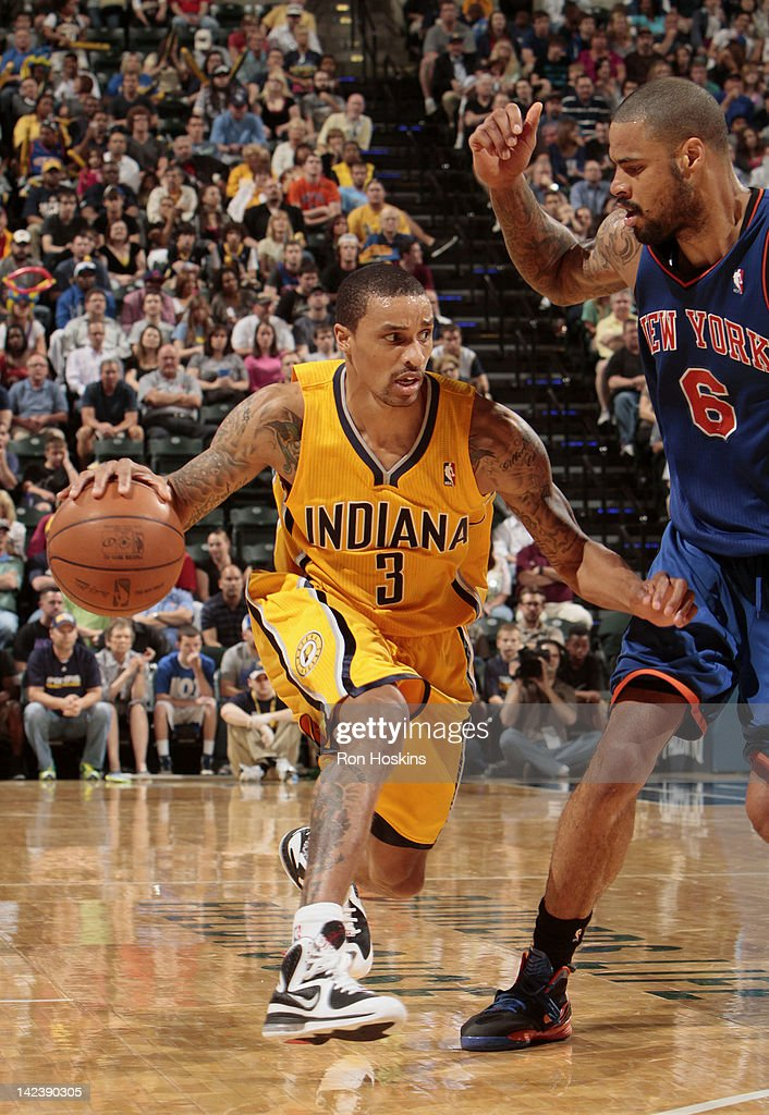 George Hill #3 of the Indiana Pacers drives to the basket against Tyson Chandler #6 of the New York Knicks during the game on April 3, 2012 at Bankers Life Fieldhouse in Indianapolis, Indiana.