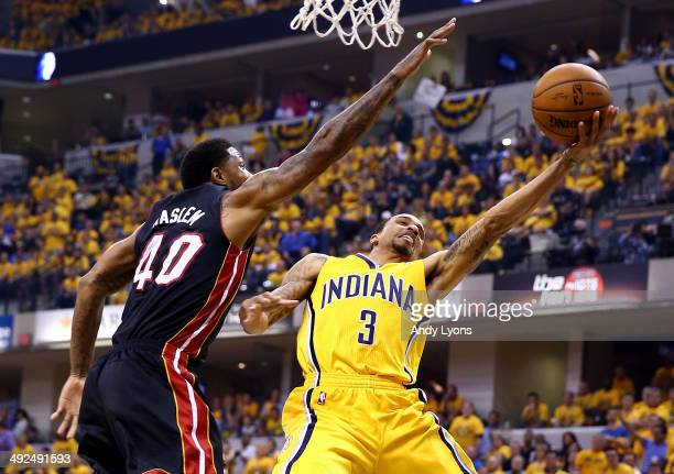 George Hill of the Indiana Pacers goes to the basket as Udonis Haslem of the Miami Heat defends during Game Two of the Eastern Conference Finals of...
