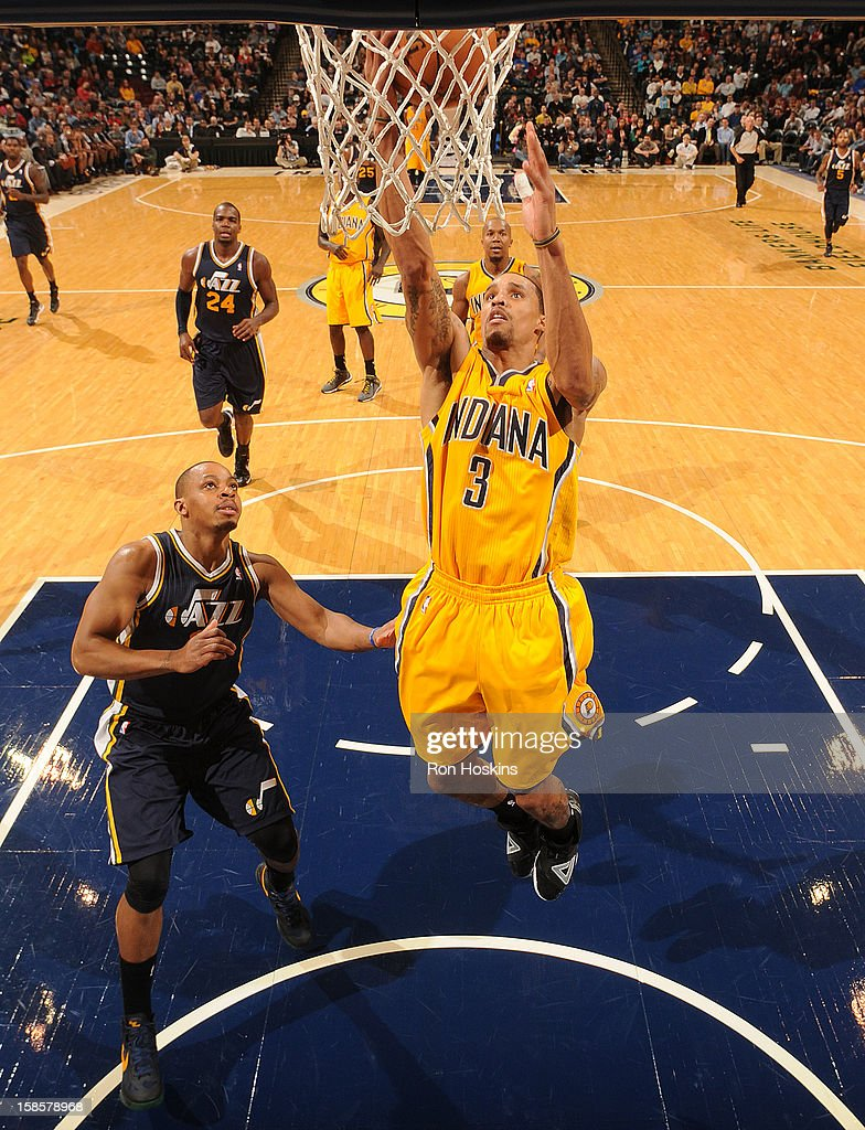 George Hill #3 of the Indiana Pacers goes to the basket during the game between the Indiana Pacers and the Utah Jazz on December 19, 2012 at Bankers Life Fieldhouse in Indianapolis, Indiana.