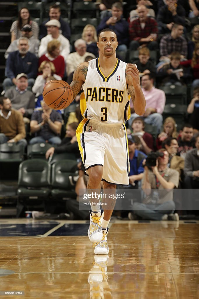George Hill #3 of the Indiana Pacers handles the ball up court against the Philadelphia 76ers on December 14, 2012 at Bankers Life Fieldhouse in Indianapolis, Indiana.