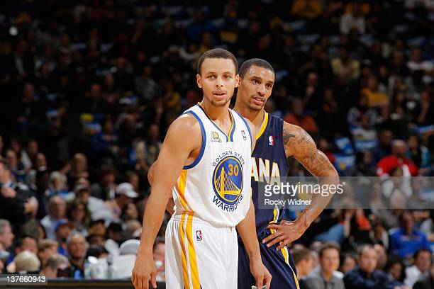 George Hill of the Indiana Pacers prepares to guard Stephen Curry of the Golden State Warriors on January 20 2012 at Oracle Arena in Oakland...
