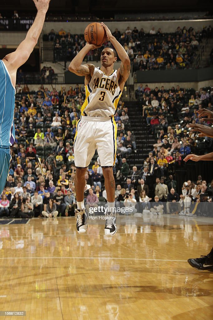 George Hill #3 of the Indiana Pacers shoots a jumper vs New Orleans Hornets on November 21, 2012 at Bankers Life Fieldhouse in Indianapolis, Indiana.
