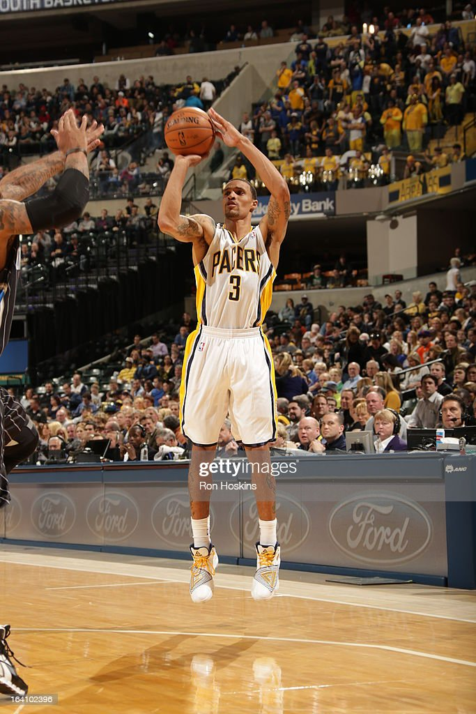 George Hill #3 of the Indiana Pacers shoots a jumpshot against the Orlando Magic on March 19, 2013 at Bankers Life Fieldhouse in Indianapolis, Indiana.