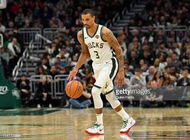 George Hill of the Milwaukee Bucks handles the ball in the second half against the Brooklyn Nets at Fiserv Forum on April 06 2019 in Milwaukee...
