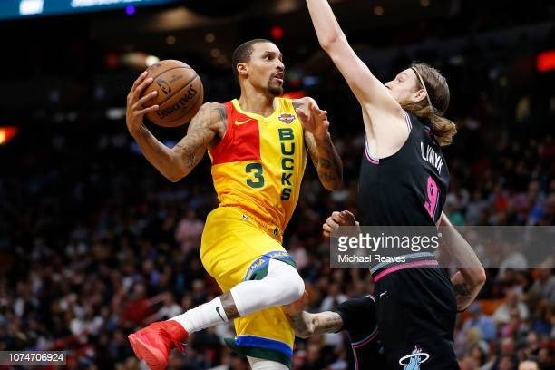 George Hill of the Milwaukee Bucks in action against the Miami Heat at American Airlines Arena on December 22 2018 in Miami Florida NOTE TO USER User...