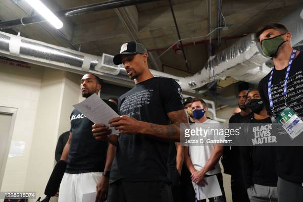 George Hill of the Milwaukee Bucks reads a statement to the media on August 26, 2020 at AdventHealth Arena at ESPN Wide World of Sports Complex in...