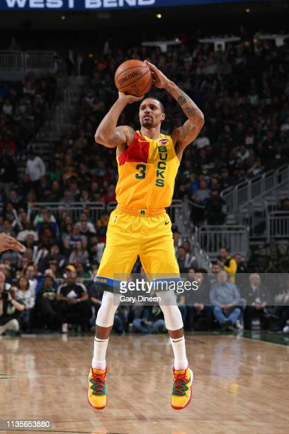 George Hill of the Milwaukee Bucks shoots three point basket against the Atlanta Hawks on April 7 2019 at the Fiserv Forum Center in Milwaukee...