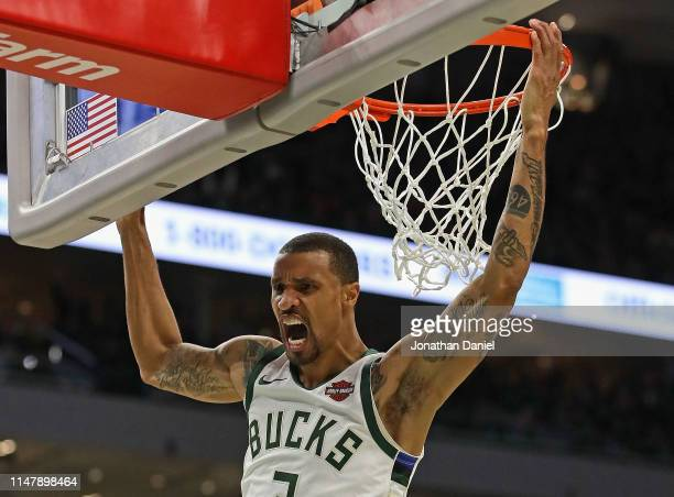 George Hill of the Milwaukee Bucks yells after a dunk against the Boston Celtics at Fiserv Forum on May 08 2019 in Milwaukee Wisconsin The Bucks...