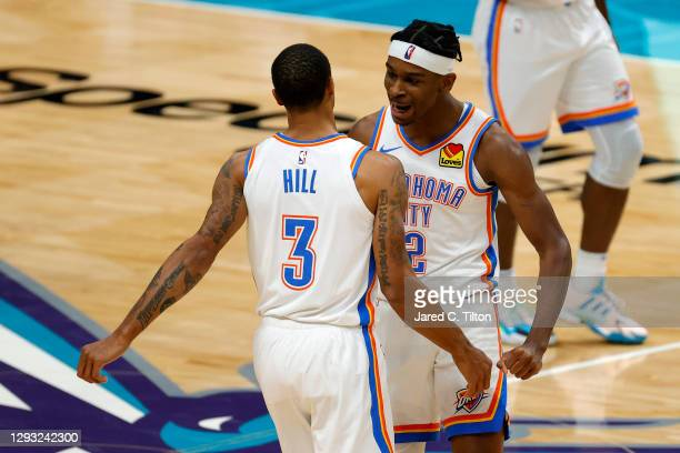 George Hill of the Oklahoma City Thunder celebrates with teammate Shai Gilgeous-Alexander following a three point basket by Hill during the fourth...