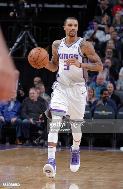 George Hill of the Sacramento Kings brings the ball up the court against the Denver Nuggets on November 20 2017 at Golden 1 Center in Sacramento...