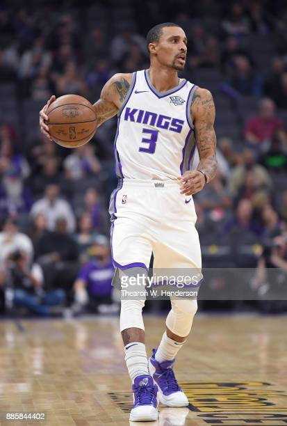 George Hill of the Sacramento Kings dribbles the ball against the Milwaukee Bucks during their NBA basketball game at Golden 1 Center on November 28...
