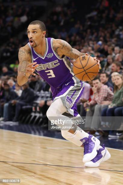 George Hill of the Sacramento Kings dribbles the ball against the Minnesota Timberwolves on December 14 2017 at Target Center in Minneapolis...